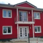 Hausbaufirma Berlin Musterhaus rot